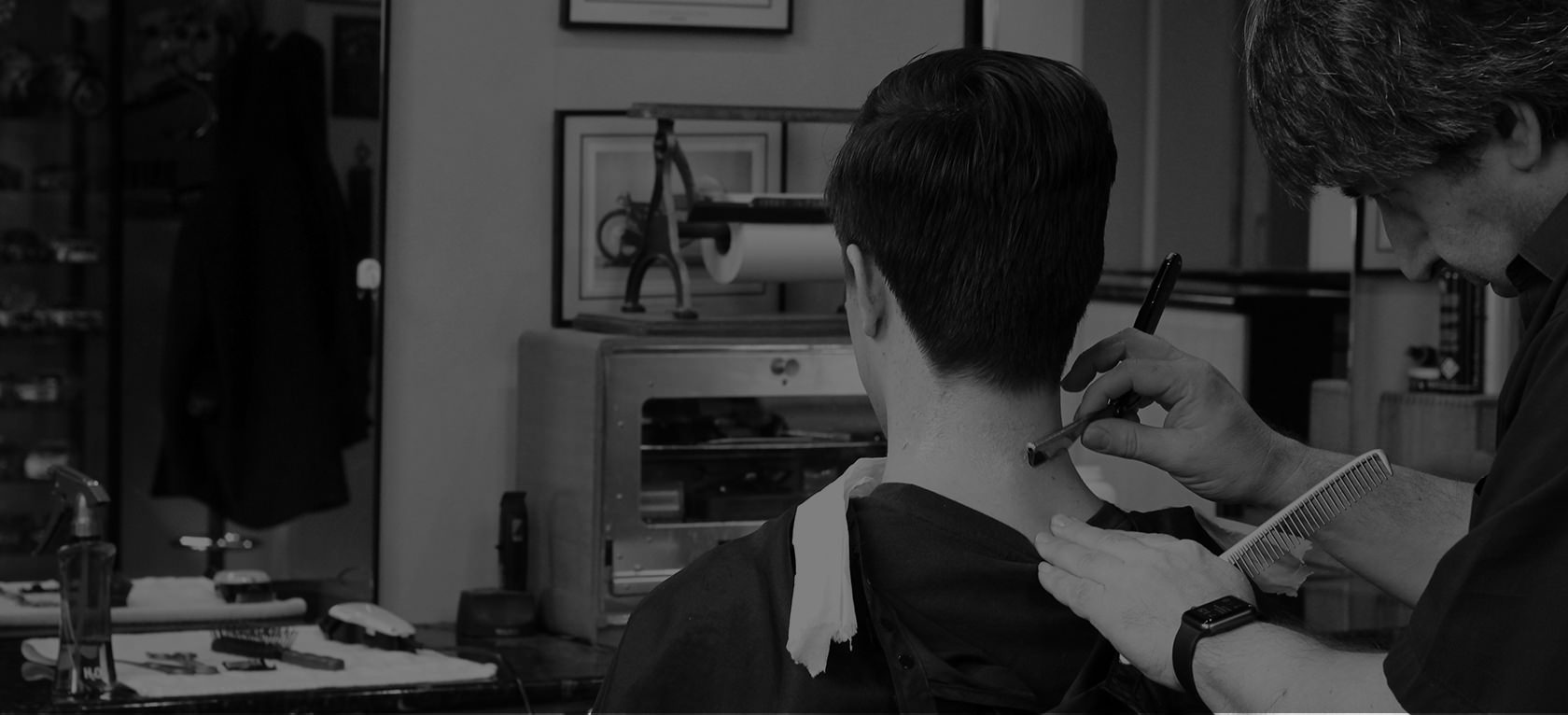 George giving a close neckline shave